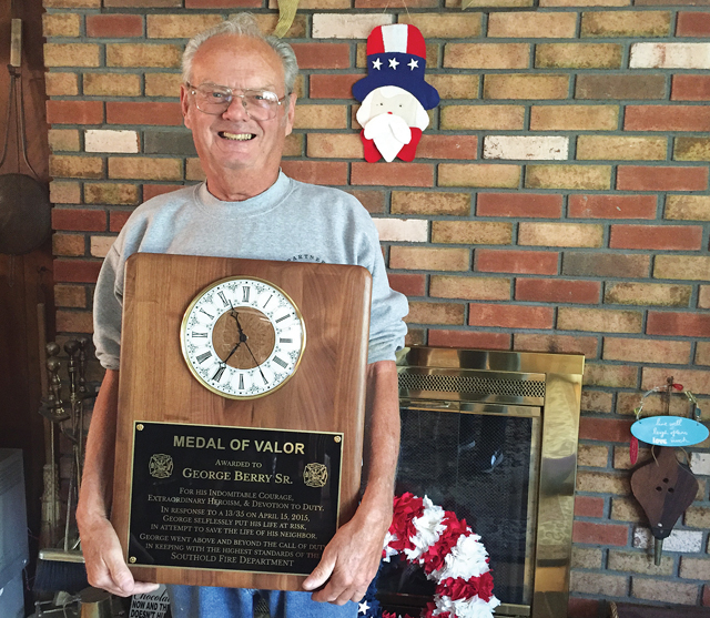 George Berry Sr. holds his plaque. (Credit: Paul Squire)