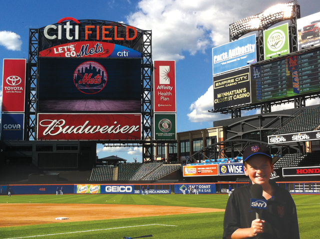 David Okula holds the SNY microphone on the field at Citi Field last week. (Credit: courtesy photo)
