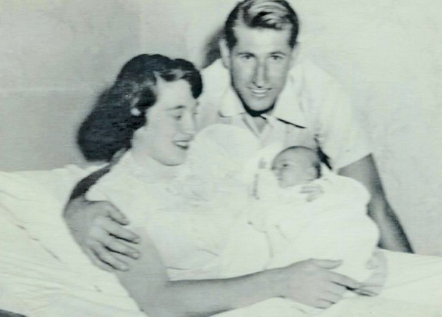 Thomas and Joan Young pose with their baby, Joan Elizabeth, at Eastern Long Island Hospital on the day she  was born in 1954. (Credit: Young Family)