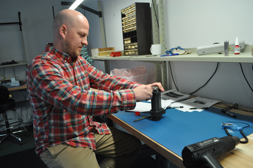 Ultra Motion owner Sean Rodger prepares an actuator for a test rig last week at the company's headquarters in Cutchogue. (Photo by Rachel Young)