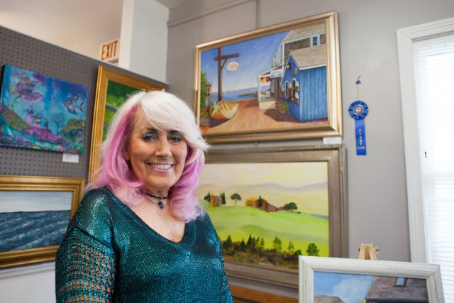 """JoAnn Corretti of Mattituck with her first place """"The Tavern."""""""