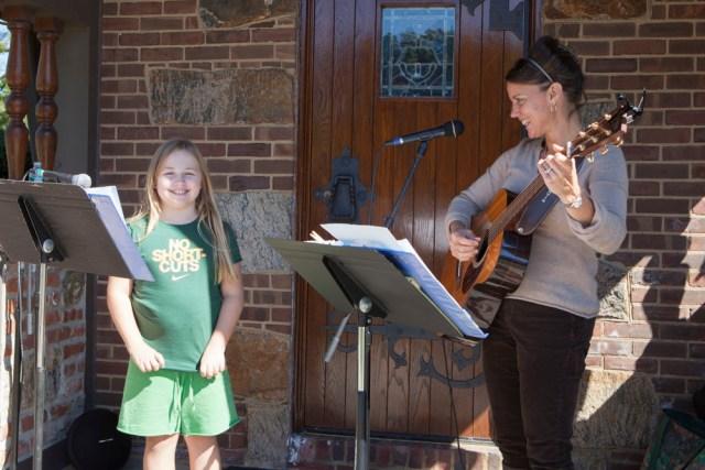 Maya Hamilton, 10, of Cutchogue sings with Patti Homan.