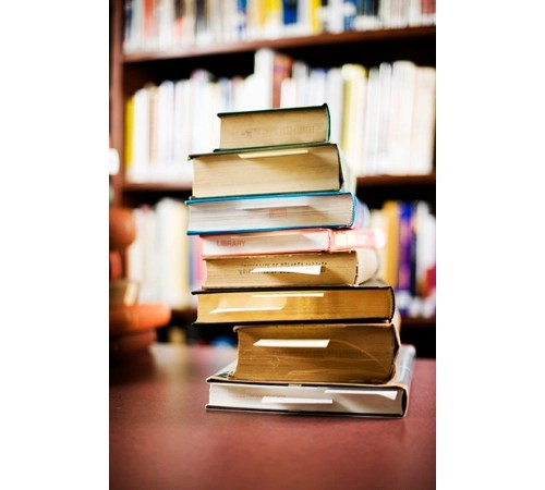 Books can tend to pile up over time. (Credit: Corbis Images)