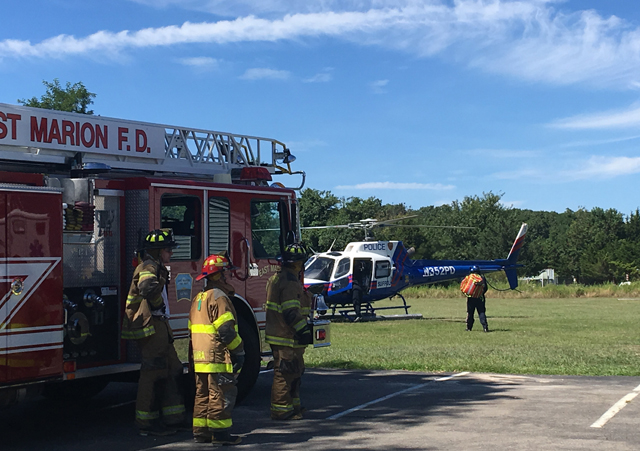 A Suffolk police helicopter landed in East Marion, but the patient was transported by ambulance instead. (Credit: Krysten Massa)