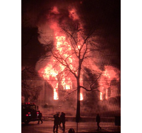 First Universilist Church in Southold in flames Saturday night. (Credit: Kathryn Zukowski)