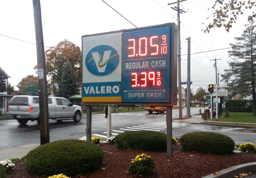 The Valero sign in Jamesport reflecting the cash price of $3.05 per gallon of regular gasoline Thursday afternoon. (Credit: Jen Nuzzo)
