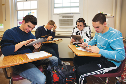 KATHARINE SCHROEDER PHOTO   Students in Ms. Salmaggi's class work with iPads Tuesday morning at Southold High School.