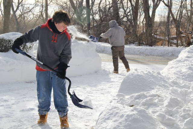 Joseph Henry, 15, and Raymond Topping, 32, cleaning up what was left behind.