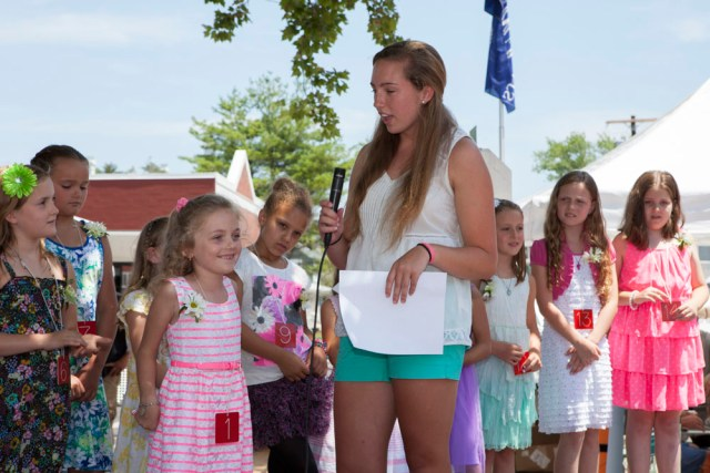 Co-host Molly Kowalski questions contestants at the Little Miss Mattituck contest. (Credit: Katharine Schroeder)