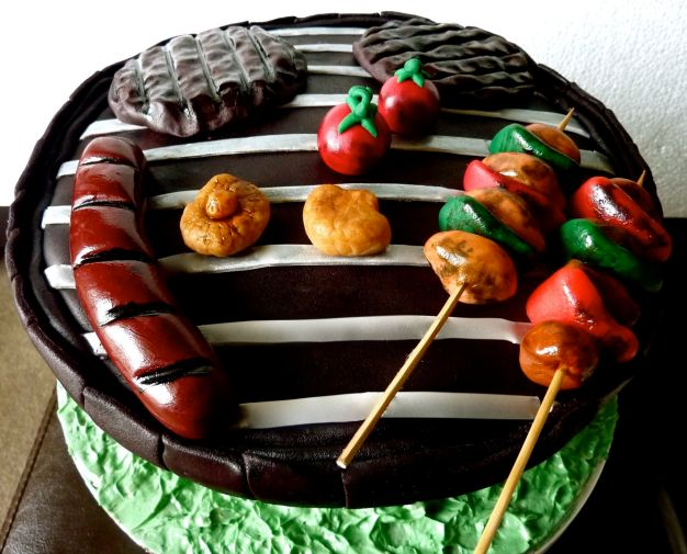 Barbecue moscato cake with sausage, patties, mushroom, tomato and skewers