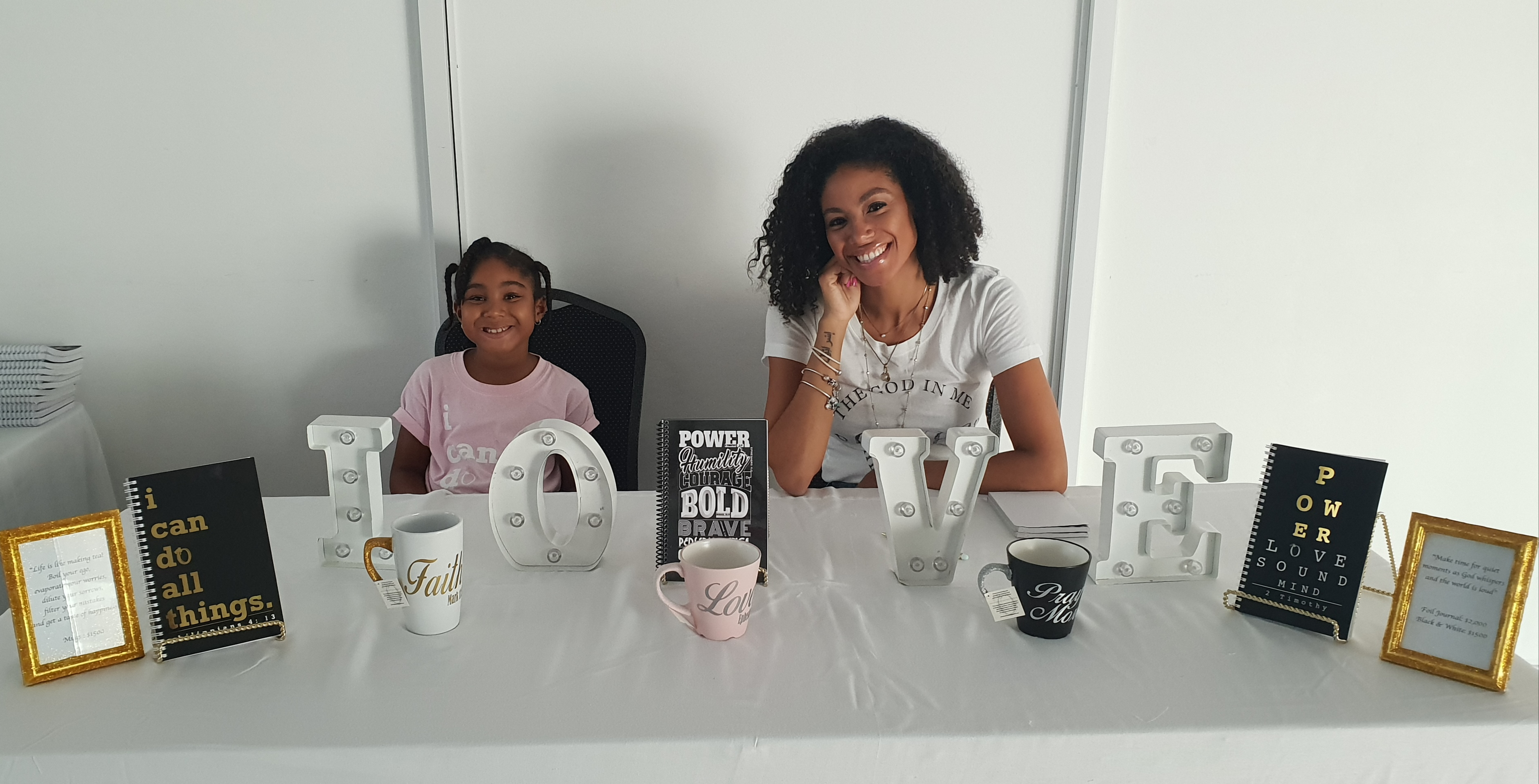 Yendi Phillips with her daughter, Israel at her Odyssey Pop-Up Shop at The Spanish Court Hotel on Sunday, July 22, 2018.