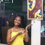 Artist, Gabrielle Burgess with her painting 'Two of a Kind' at Art Wednesdays at The Reggae Mill Bar, Devon House