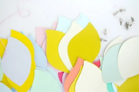 cutting paper flowers from paint swatches