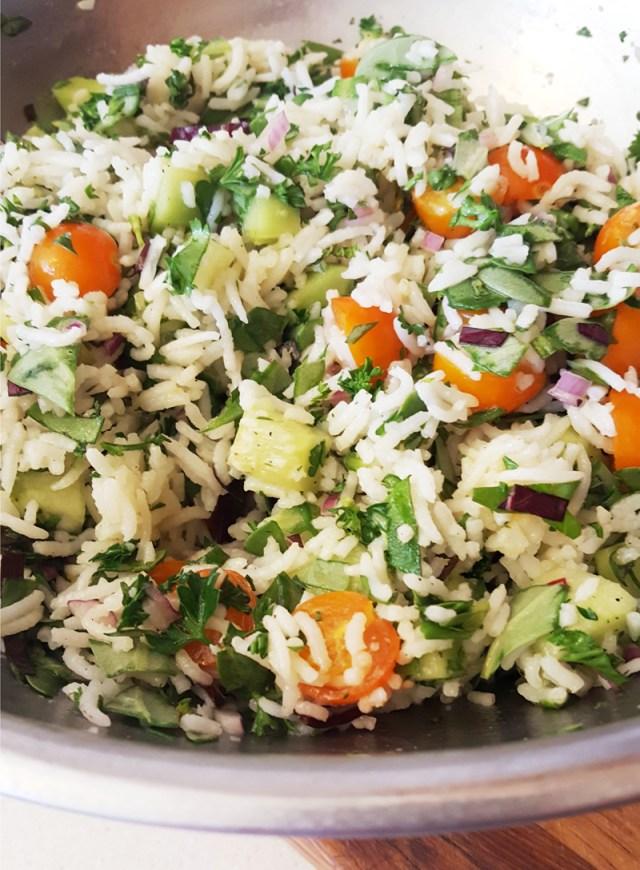 Purslane rice salad, rice with tomatoes cucumber and purslane