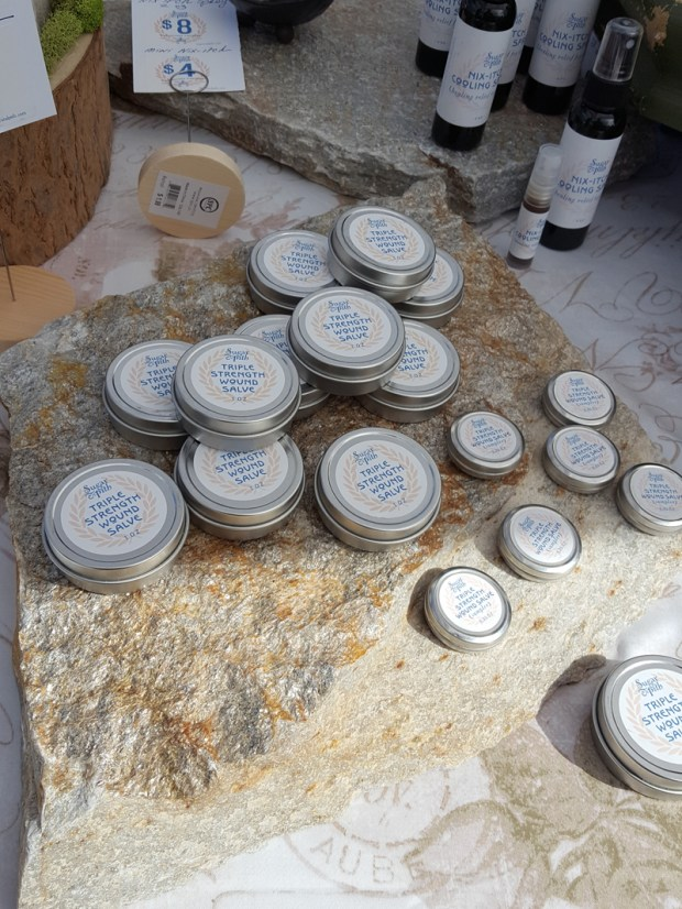 Sugar and Pith triple strength wound salve displayed on a slate stone