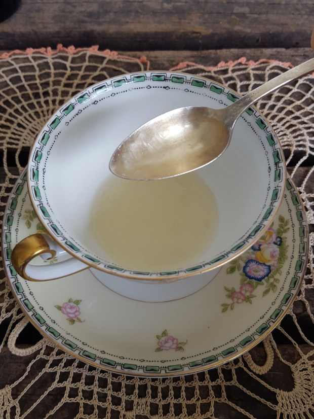 Sugar and Pith, antique tea cup and silver spoon filled with eye mask ingredients