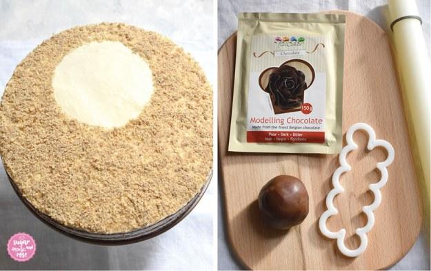 Die undekorierte Walnusstorte links, daneben ein Holzbrett mit den Zutaten für die Schokoladerosen: Modellierschokolade-Packung, eine Schokoladenkugel, ein Fondant-Roller und eine Ausstechform für Rosenblüten