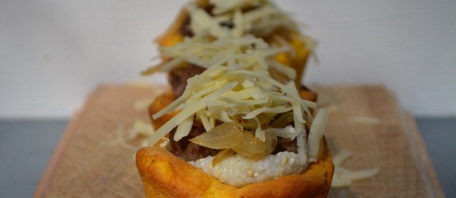 Pumpkin Biscuit Cups with Grits, Sausage, Caramelized Onion and Cheddar Cheese