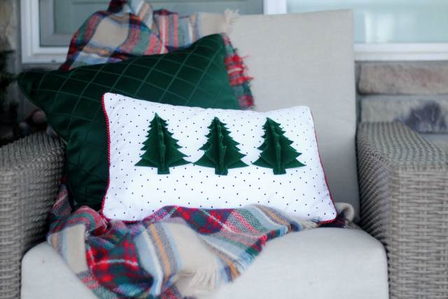 Make fun holiday porch decor using the Cricut Maker! Get all the full tutorials at sugarcoatedhousewife.com