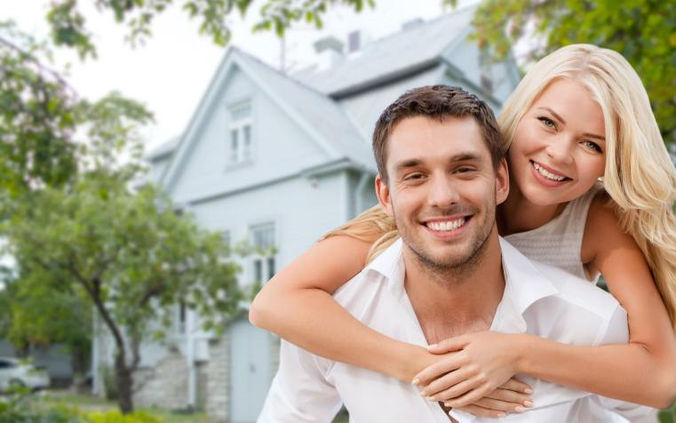 happy-couple-showing-affection-outside-their-house