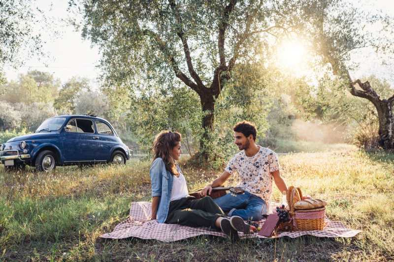 couple-in-the-woods-having-a-picnic