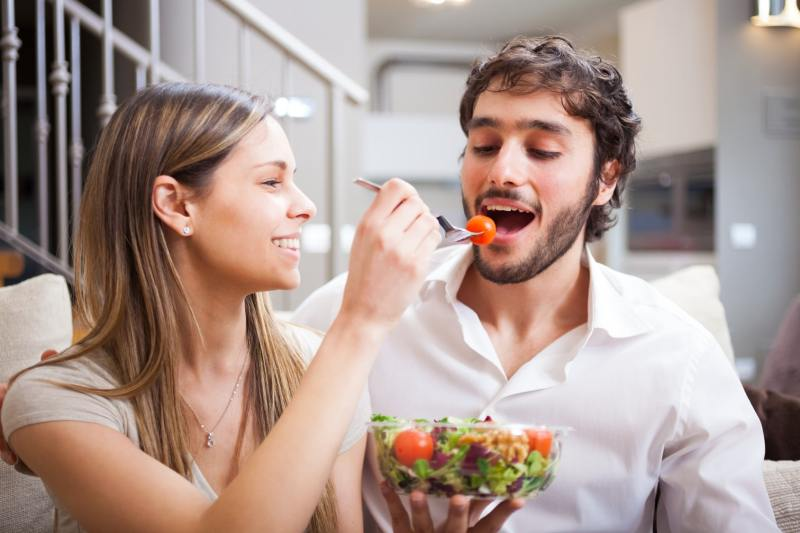 Couple eating a salad on a date