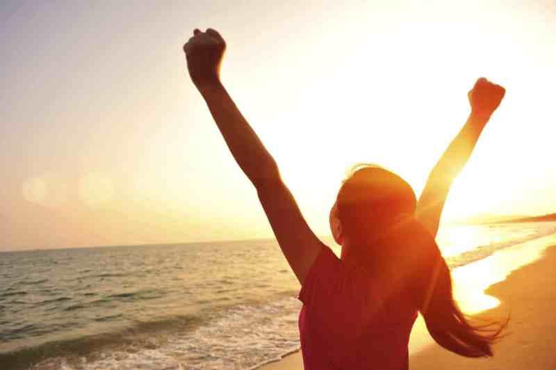 girl on beach with sunrise