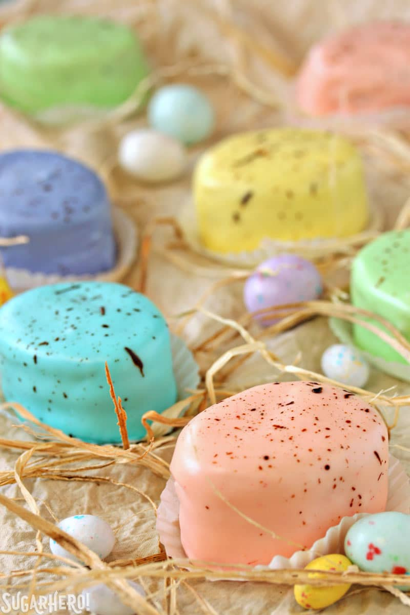 Easter Egg Petit Fours - assortment of pastel petit fours that look like speckled Easter eggs | From SugarHero.com