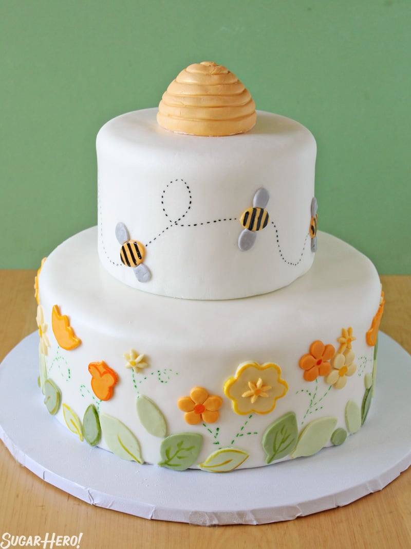 Bumblebee Cake - Shot of the layered cake with flowers and bees made of fondant. | From SugarHero.com