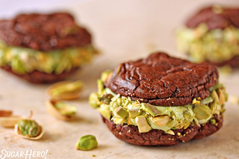 Chocolate-Pistachio Sandwich Cookies - Straight shot of the pistachio sandwich cookie. | From SugarHero.com