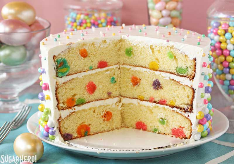 Easter Polka Dot Cake - Polka dot cake with slices taken out, showing the polka dots inside.  | From SugarHero.com