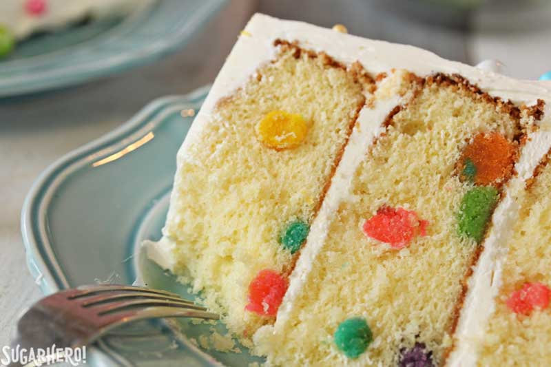 Easter Polka Dot Cake -  A slice of cake with a bite taken out. | From SugarHero.com