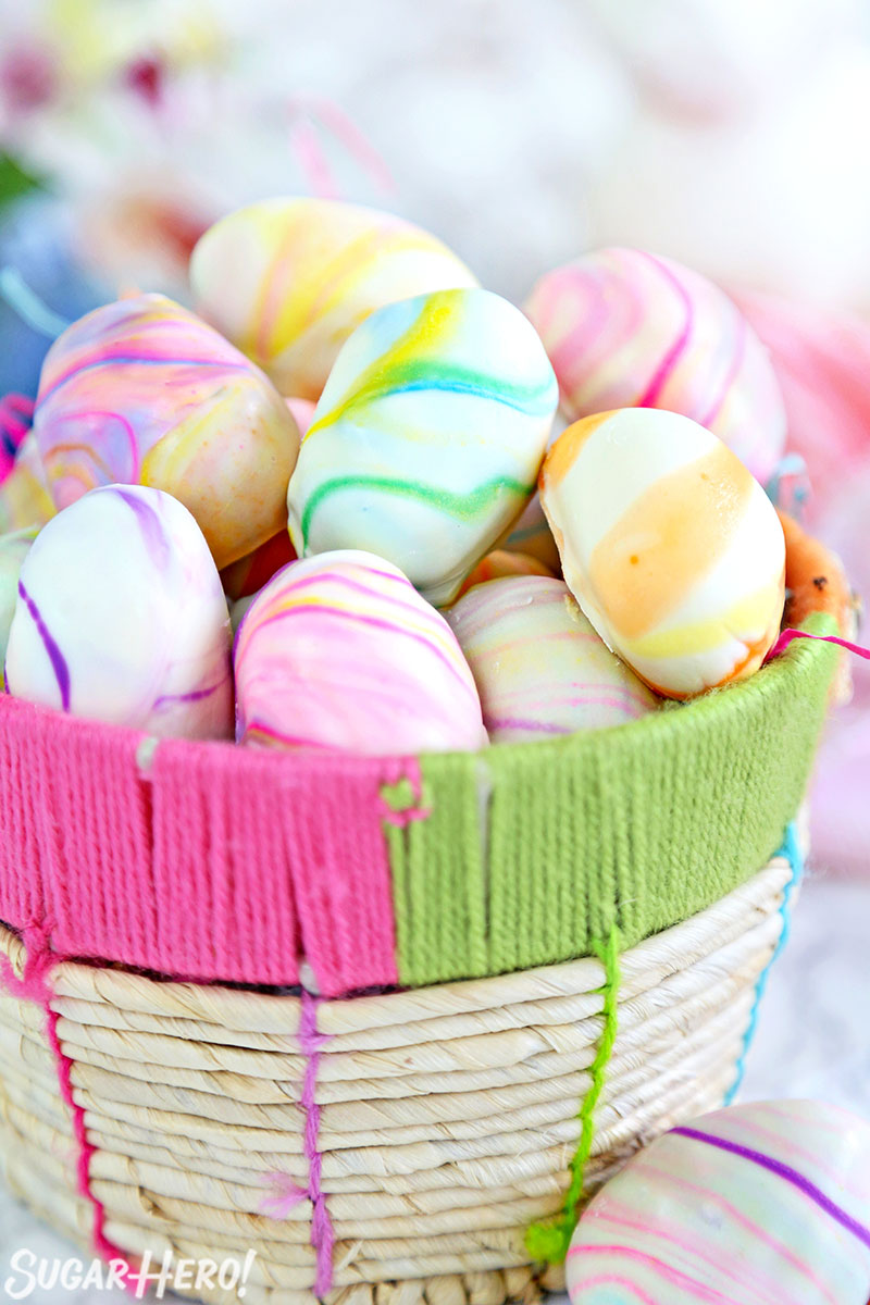 Marbled Easter Egg Truffles - Truffles displayed in a basket. | From SugarHero.com