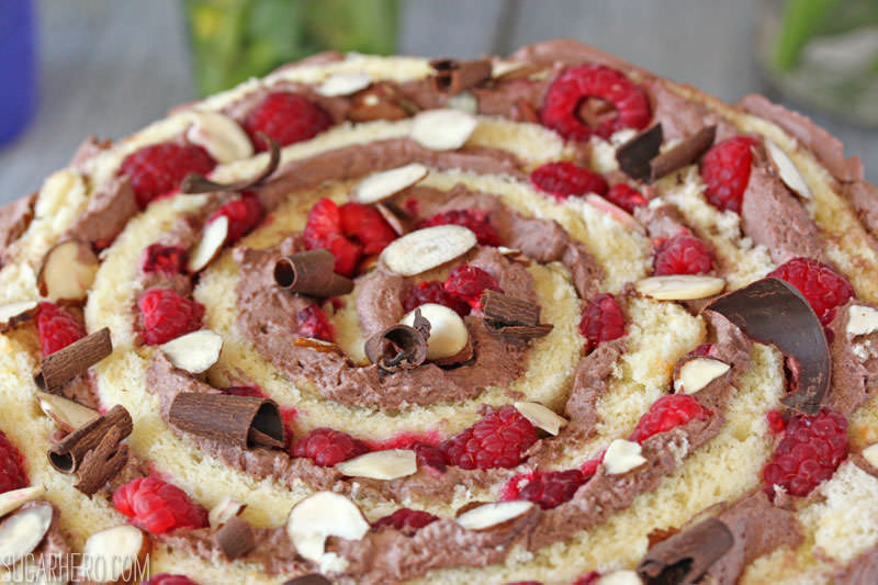 Raspberry Almond Spiral Cake - almond cake, chocolate whipped cream, and berries, rolled into a spiral! | From SugarHero.com