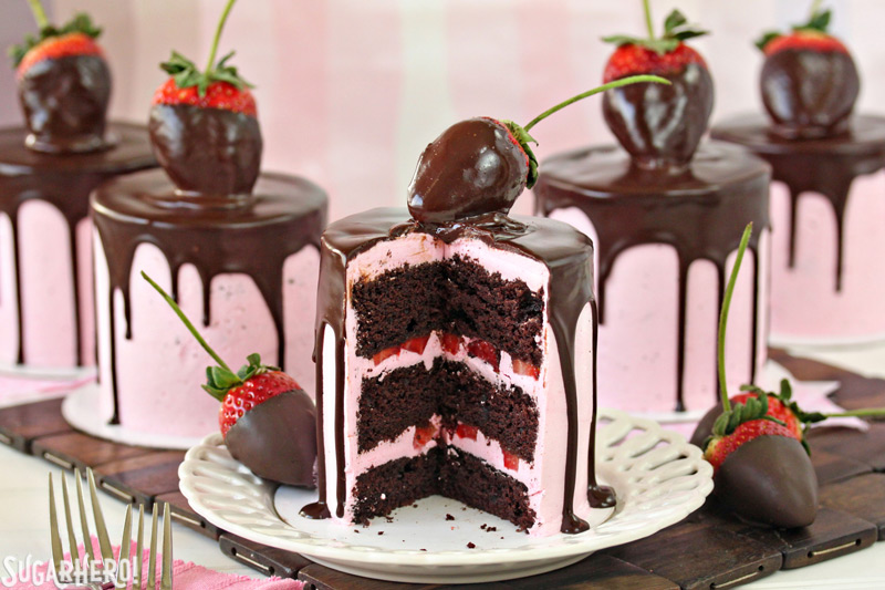 Chocolate-Covered Strawberry Cakes -Five separate cakes displayed with one having a slice taken out. | From SugarHero.com