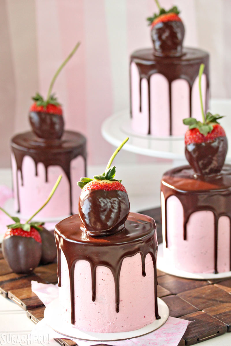 Chocolate-Covered Strawberry Cakes - Four separate cakes with chocolate dripping down the sides, and chocolate covered strawberry's on top. | From SugarHero.com