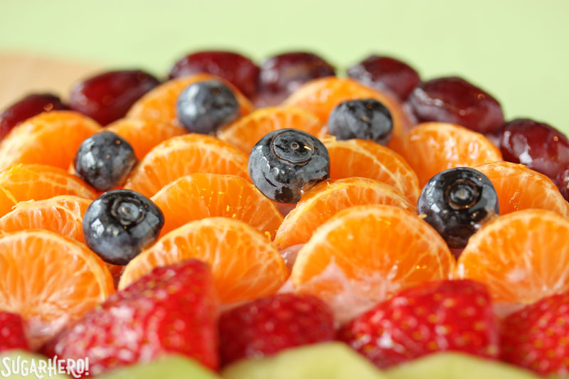 Easter Egg Fruit Pizza - A close up of the fruit on top of the pizza. | From SugarHero.com
