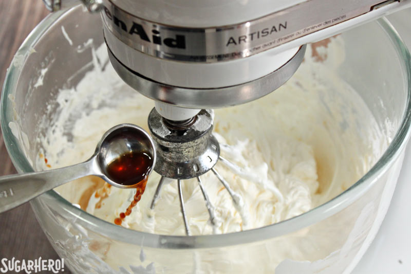 How to Make Swiss Meringue Buttercream - A photo of the vanilla being added.  | From SugarHero.com
