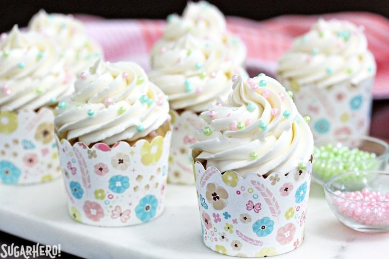 The Easiest Swiss Meringue Buttercream - A close up shot of cupcakes with piped buttercream. | From SugarHero.com