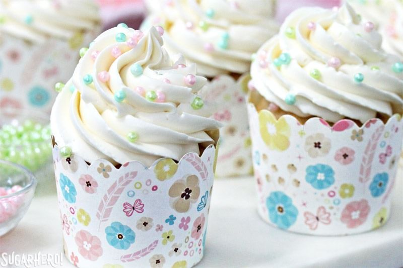 The Easiest Swiss Meringue Buttercream - A close up shot of a cupcake with piped buttercream. | From SugarHero.com