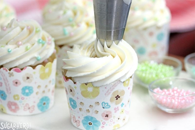 The Easiest Swiss Meringue Buttercream - A picture displaying the buttercream being piped. | From SugarHero.com