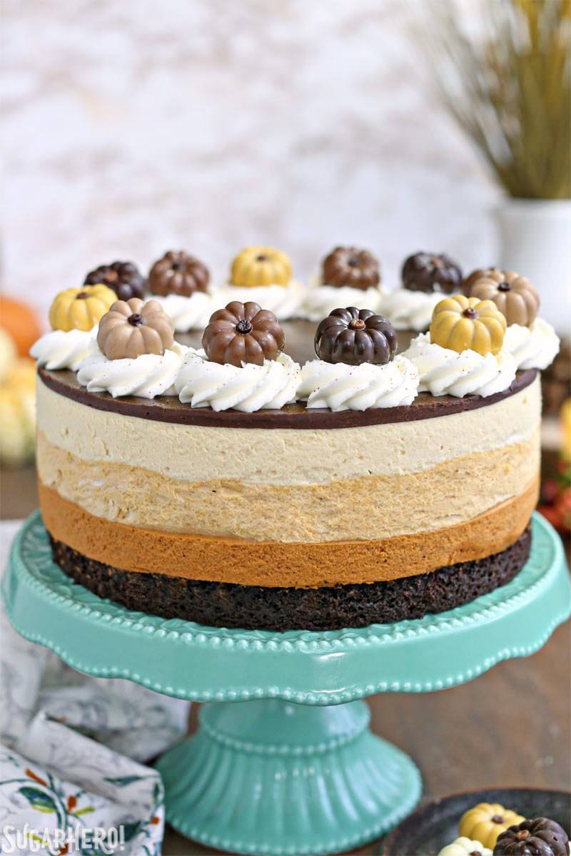 Pumpkin Chocolate Mousse Cake - A straight shot of the cake displayed on cake stand. | From SugarHero.com