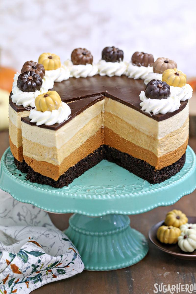 Pumpkin Chocolate Mousse Cake - The cake displayed with pieces cut out. | From SugarHero.com