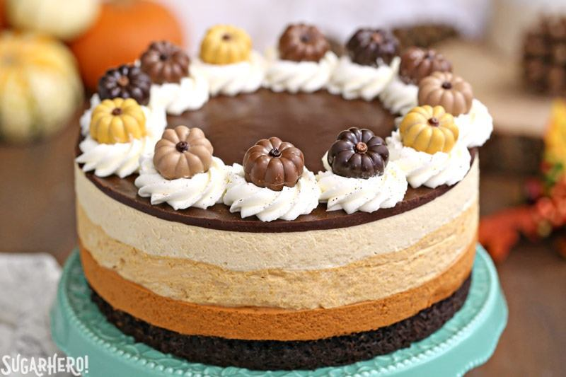 Pumpkin Chocolate Mousse Cake - A closer shot of the cake with cute pumpkin toppers. | From SugarHero.com