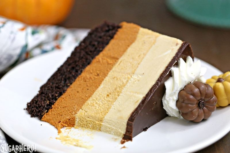 Pumpkin Chocolate Mousse Cake - A slice with a bite taken out of it. | From SugarHero.com