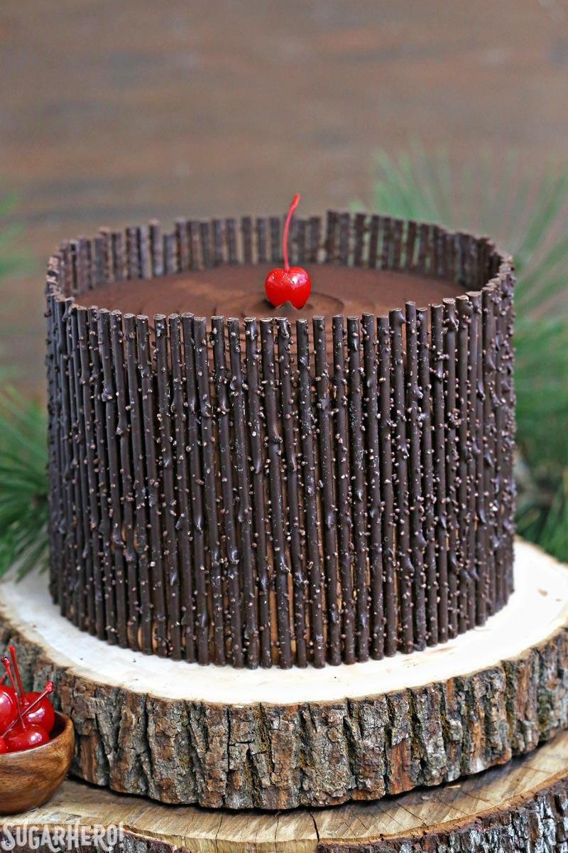 Black Forest Cake - the classic chocolate-cherry cake! Chocolate cake, cherry filling, and chocolate twigs! | From SugarHero.com