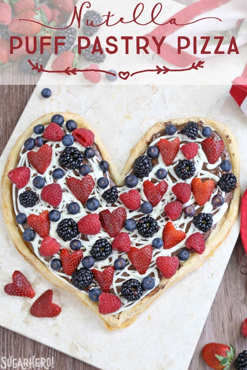 Nutella Puff Pastry Pizza is easy and delicious. You'll love the combination of buttery puff pastry, Nutella, white chocolate, and juicy fresh berries!   From SugarHero.com
