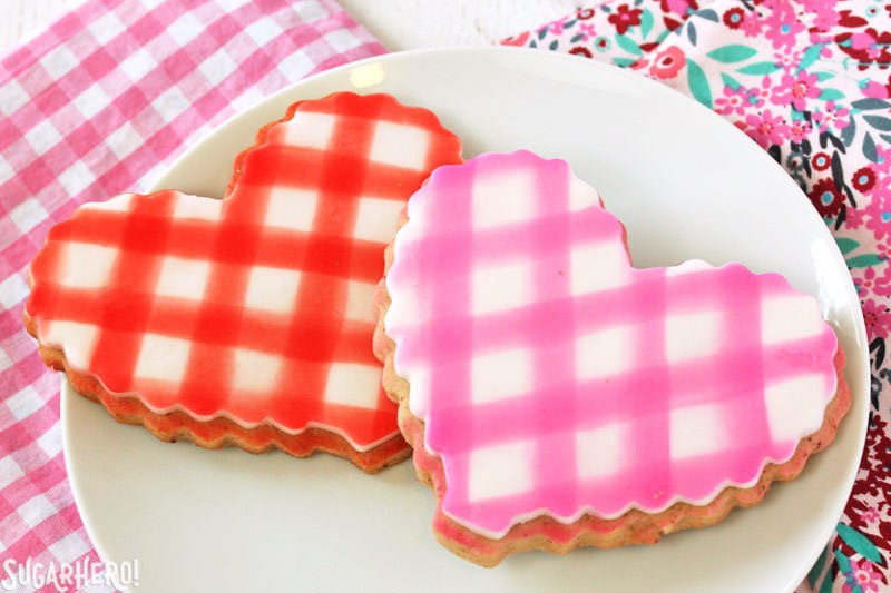 Brown Butter Heart Cookies - two cookies with gingham fondant plaques on top | From SugarHero.com