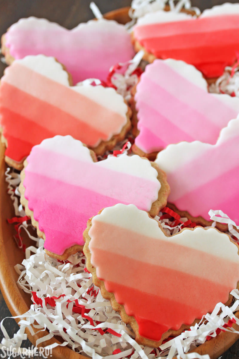 Brown Butter Heart Cookies - ombre cookies stacked in a bowl with festive paper | From SugarHero.com