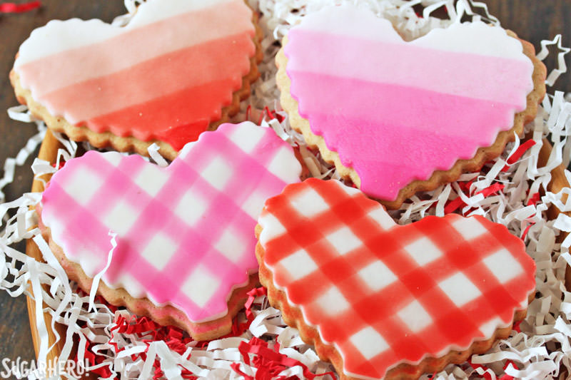 Brown Butter Heart Cookies - two gingham and two ombre cookies in a wooden bowl | From SugarHero.com